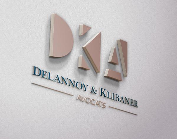 Logo Delannoy & Klibaner avocats en volume sur un mur